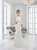 Bridal Dress: Sans Pareil Bridal Collection 2016: 975 - Twirling lace details form illusion neckline and all-over lace in trumpet style dress